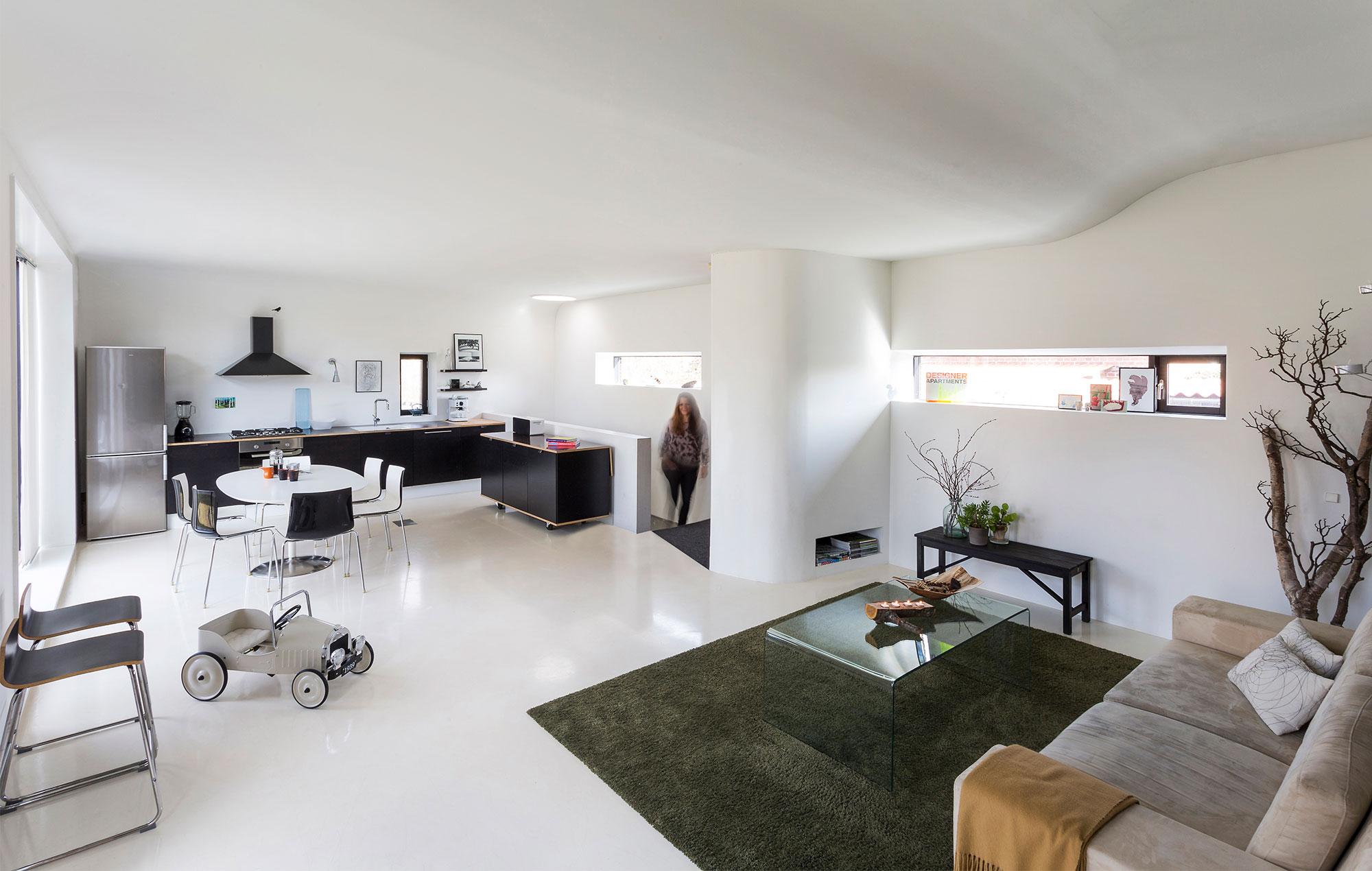 Arkitekternes togvogn i træ og beton - Danske Boligarkitekter